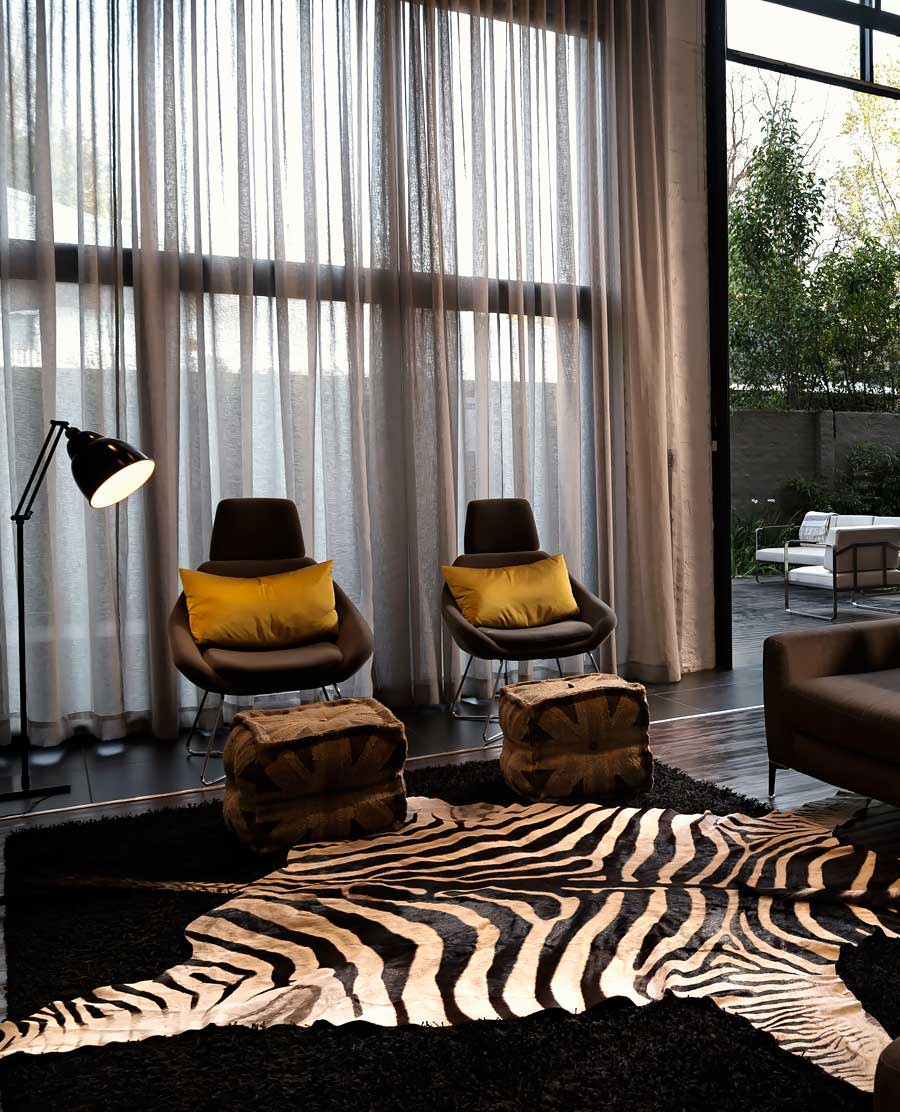 Zebra skin rug laying out on surface