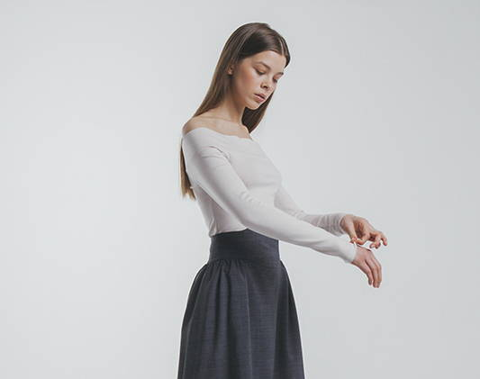 a women wears a white top