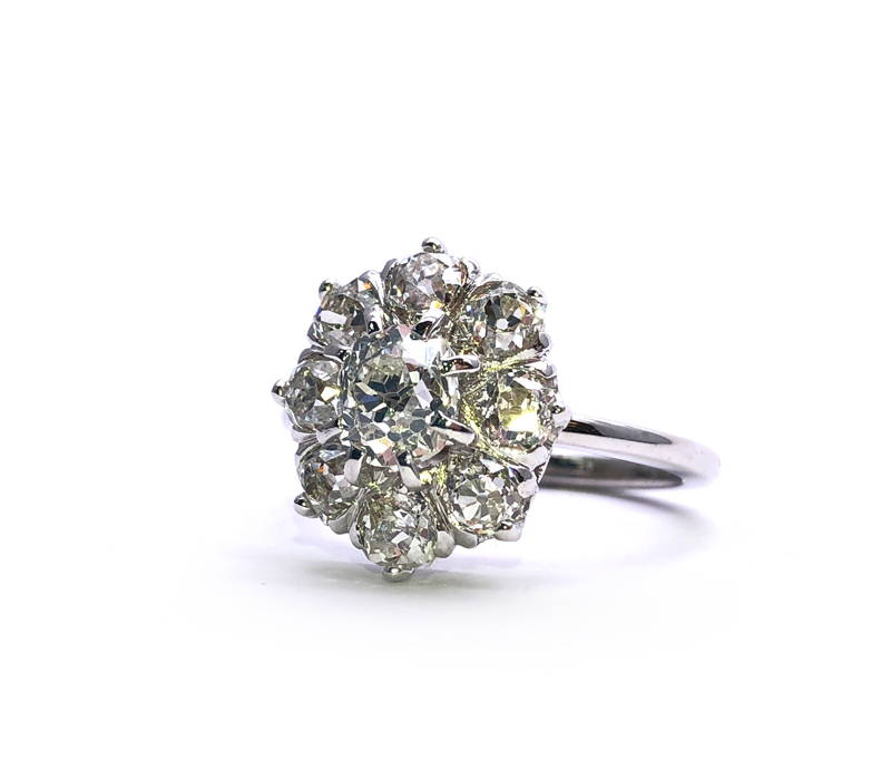 white gold flower ring with nine diamonds