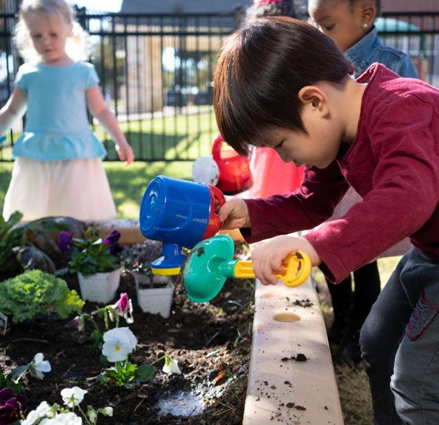 preschool boy playing outside
