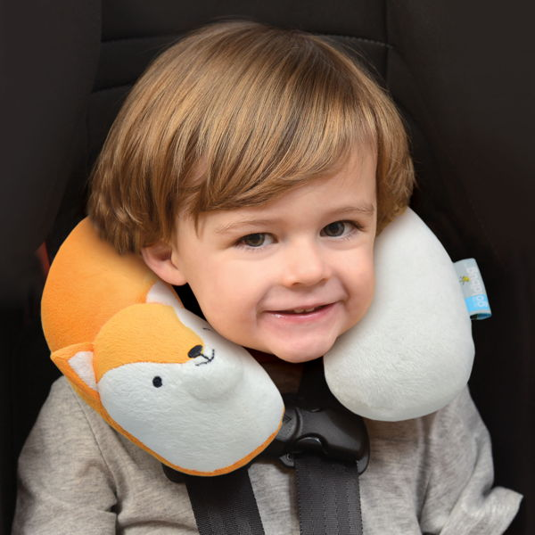 child with travel neck rolls