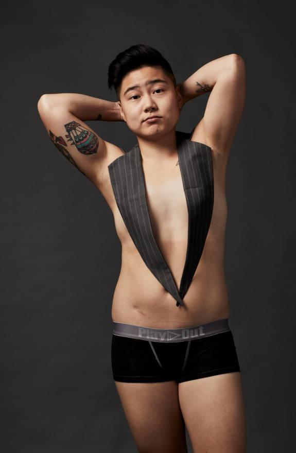 Model wears Play Out gender free boxer briefs underwear in black.