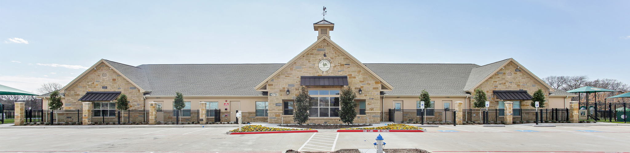image of the exterior front of Primrose School of Plano at Headquarters