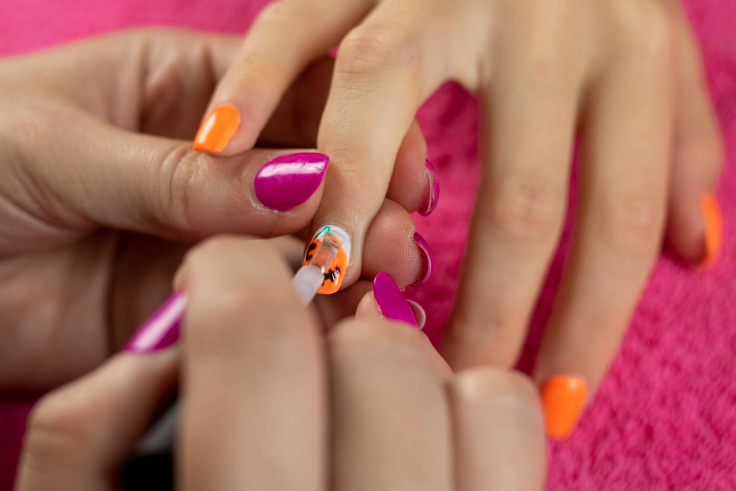ORLY Glosser Topcoat being painted onto finished pumpkin nails