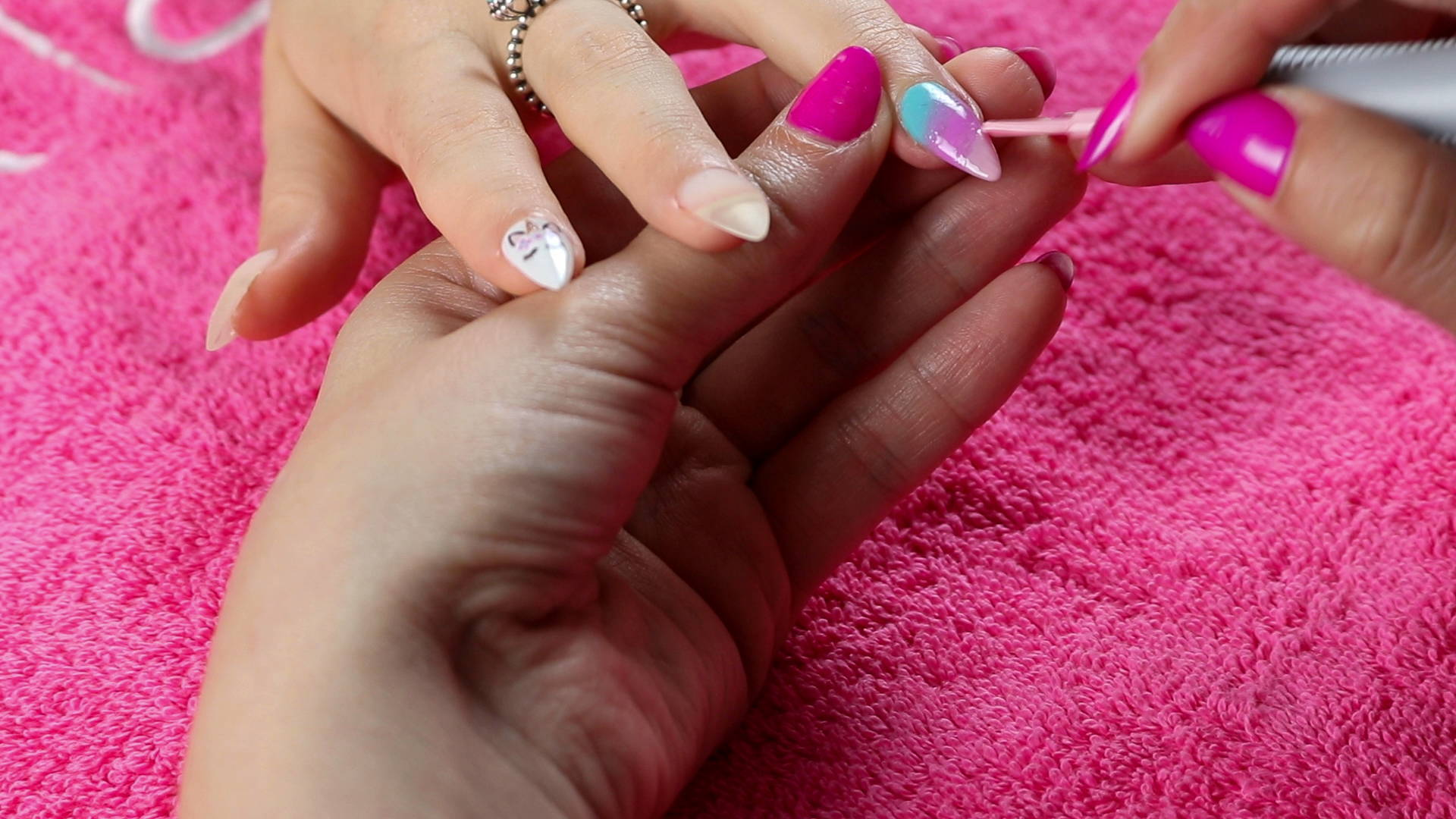 Unicorn nail art detail being painted onto a nail using ORLY GelFX Lift The Veil