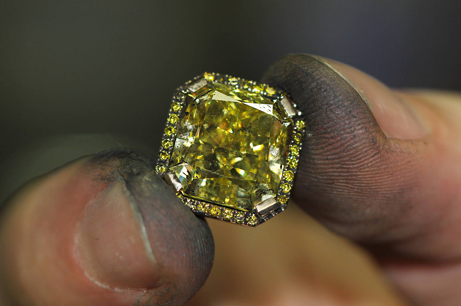 diamond in the fingers of a jewelry master