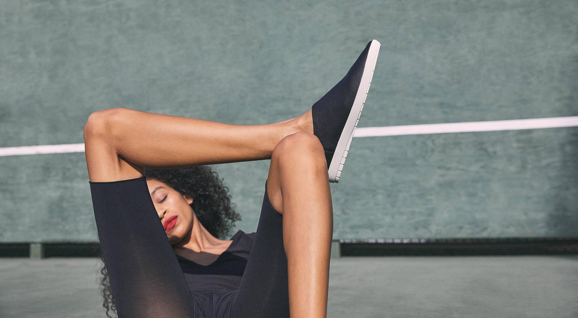 Women in Black wearing Black Shoes
