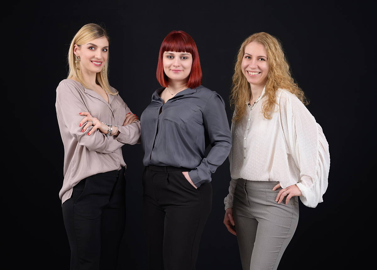 Three young female co-founders on black bacground