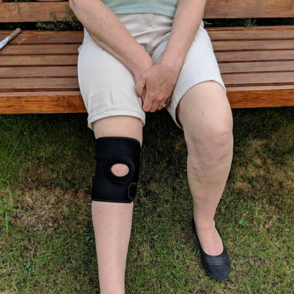 Man wearing knee support for arthritis