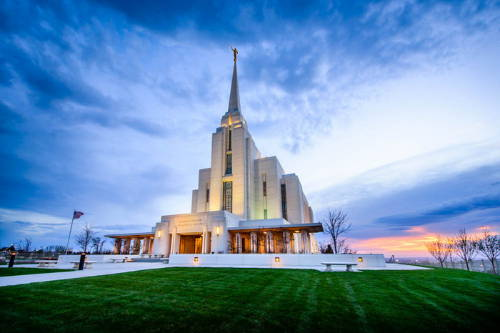 Rexburg Temple picture feautring a blue and white sky with an orange sunset.