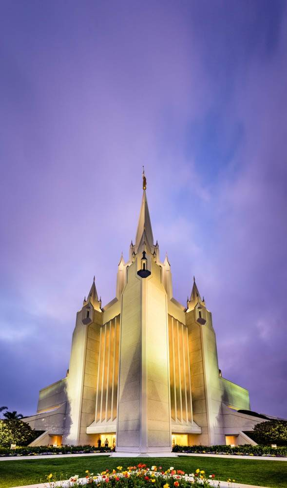 Vertical photo of the San Diego LDS Temple against a blue and purple sky.