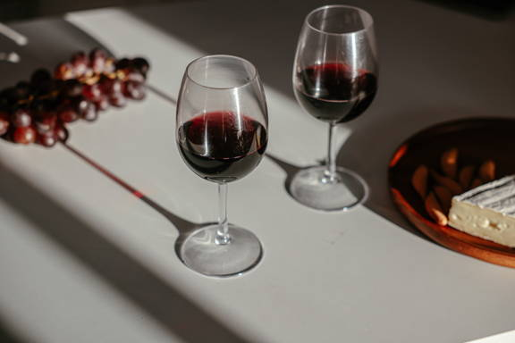 Two red wine glasses highlighting the importance a larger bowl and broader rim to increase oxidation.