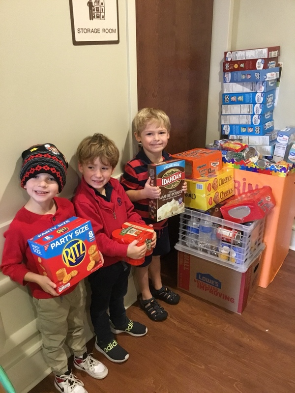 Pre-Kindergarten students proudly showing their donations!