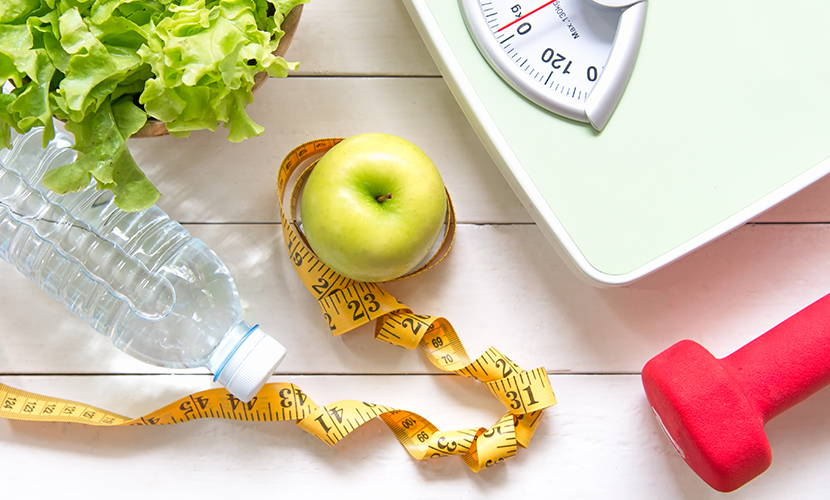 Calories control with healthy food, drink water exercises and weight control