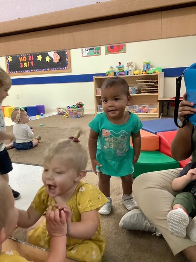 During Wonder Time, our Older Infants and Toddlers used mirror play to explore different parts of their face.