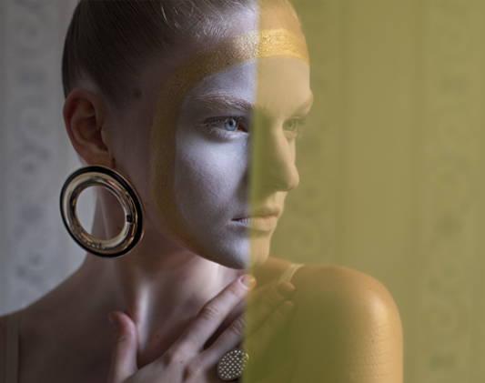 a woman wears a pair of fashion earrings