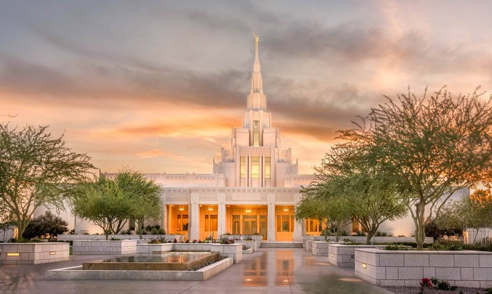 Phoenix Temple in front of orange and purple clouds.