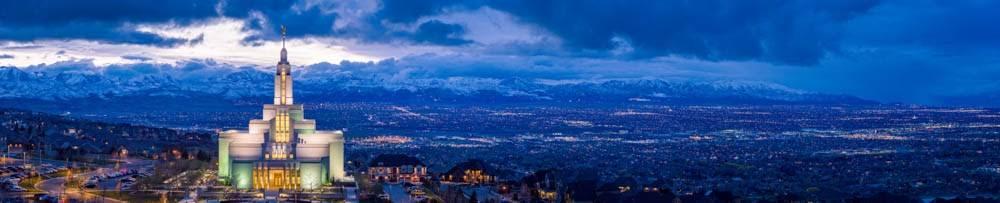 Panoramic photo of the Draper Utah LDS Temple at night.