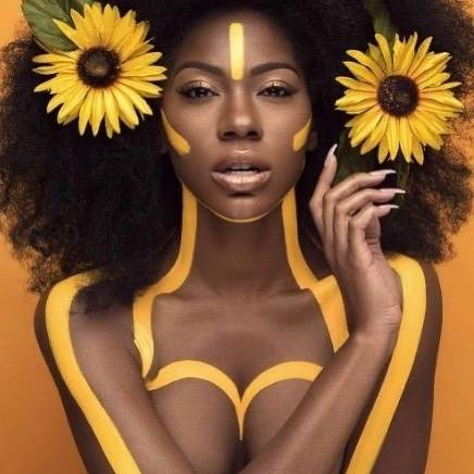 confident black woman with sunflowers
