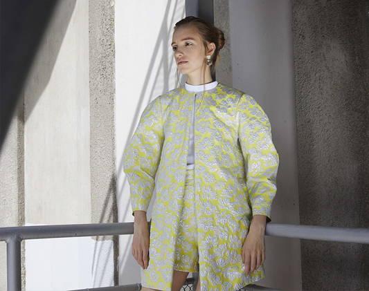 a woman wears a designer dress