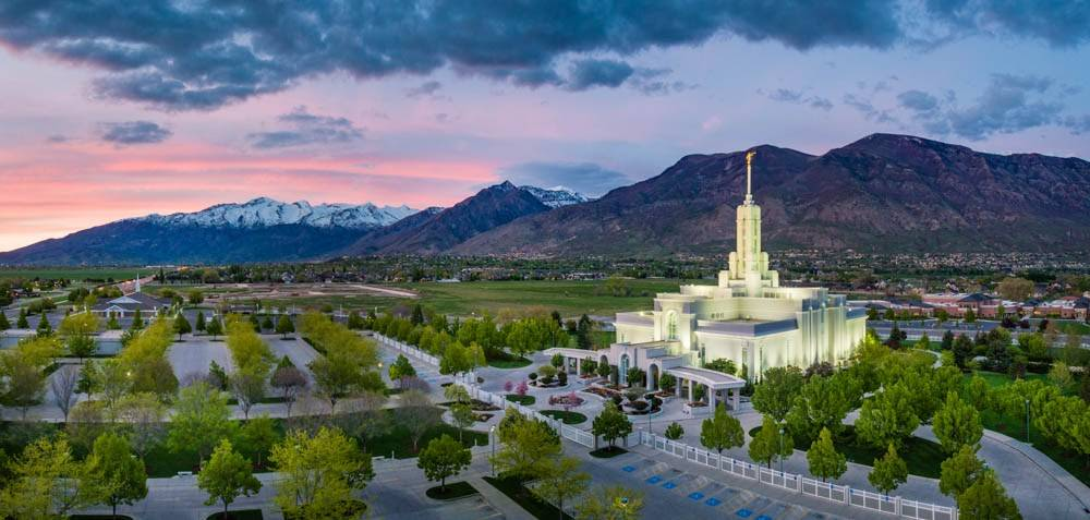LDS art panoramic photo of the Mt Timpanogos Temple and surrounding trees and mountains.