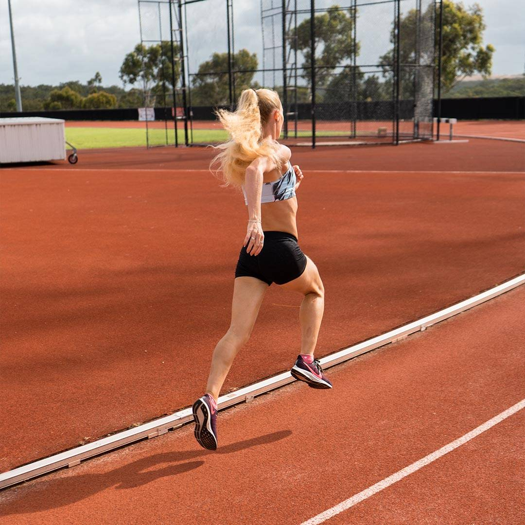 Lady running on a track