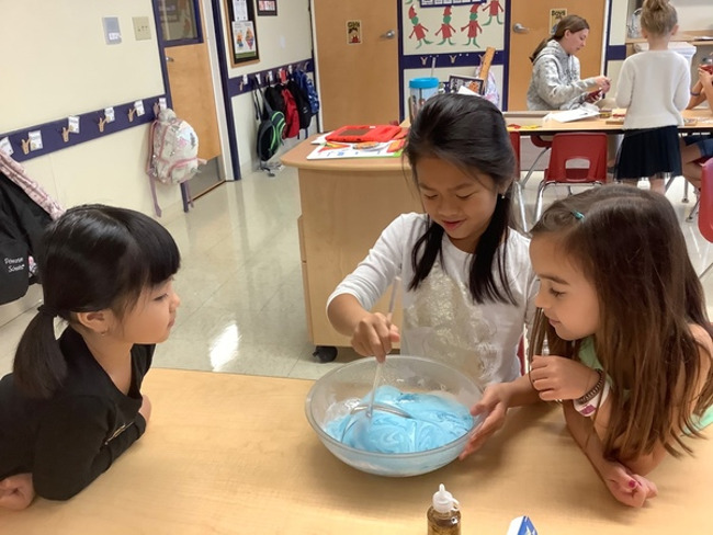 Our Explorers worked together in groups during a Science experiment.