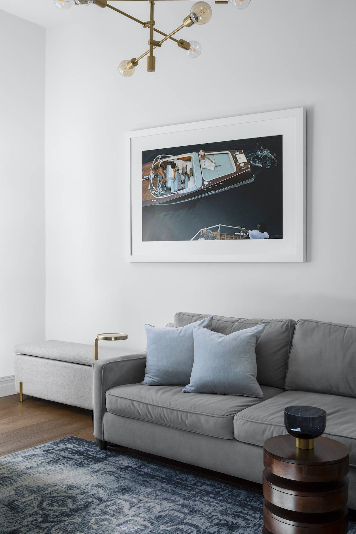A living room with framed photography above sofa