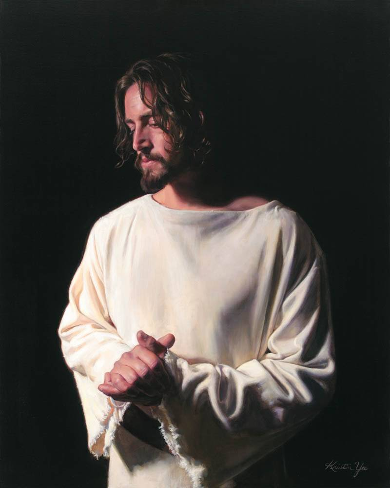 Picture of Jesus clasping His hands and looking downcast.
