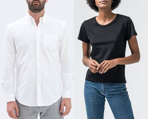 Man wearing white organic cotton oxford shirt with grey trousers and woman wearing black short sleeve t-shirt with blue indigo jeans from sustainable fashion brand Isto