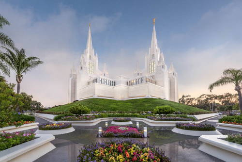 Photo of the San Diego Temple grounds against a blue sky.