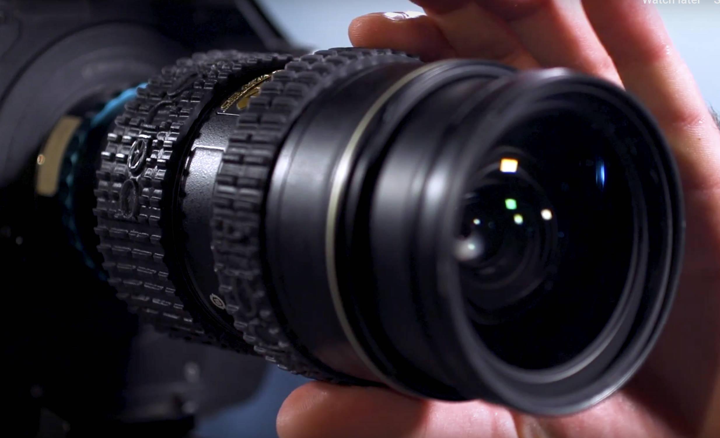 added grip on Nikon camera lenses