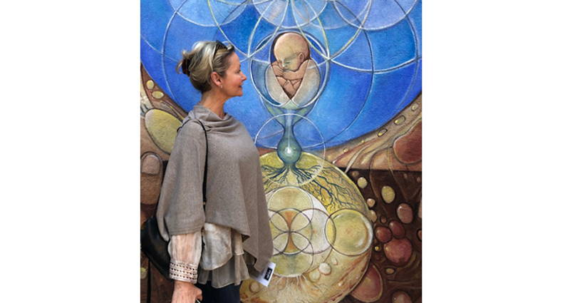 Dr Rebecca Booth views a painting symbolizing birth