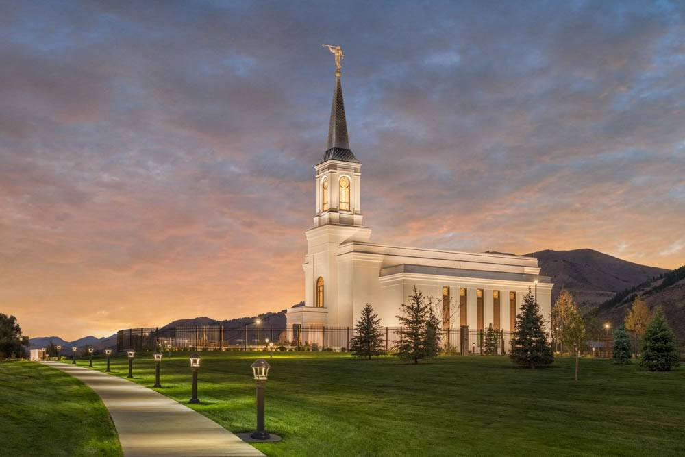 LDS art photograph of the Star Valley Wyoming Temple against an evening sky.