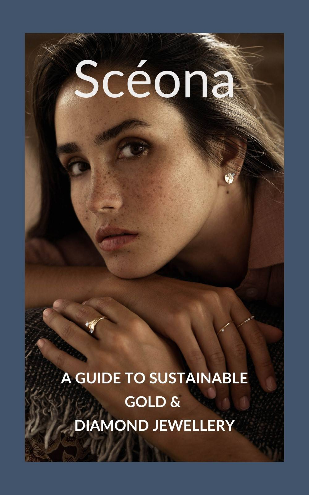 The cover of Sceona free ebook showing a woman wearing gold earrings and gold rings