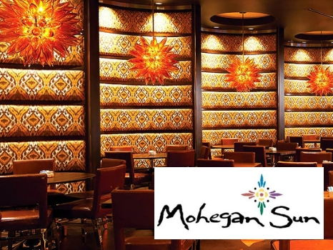 Overnight Stay for 2 at Any Foxwoods Resort Casino Hotel and Dinner for 4 at Mohegan Sun's Season's Buffet