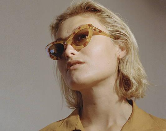 a women wearing sunglassess