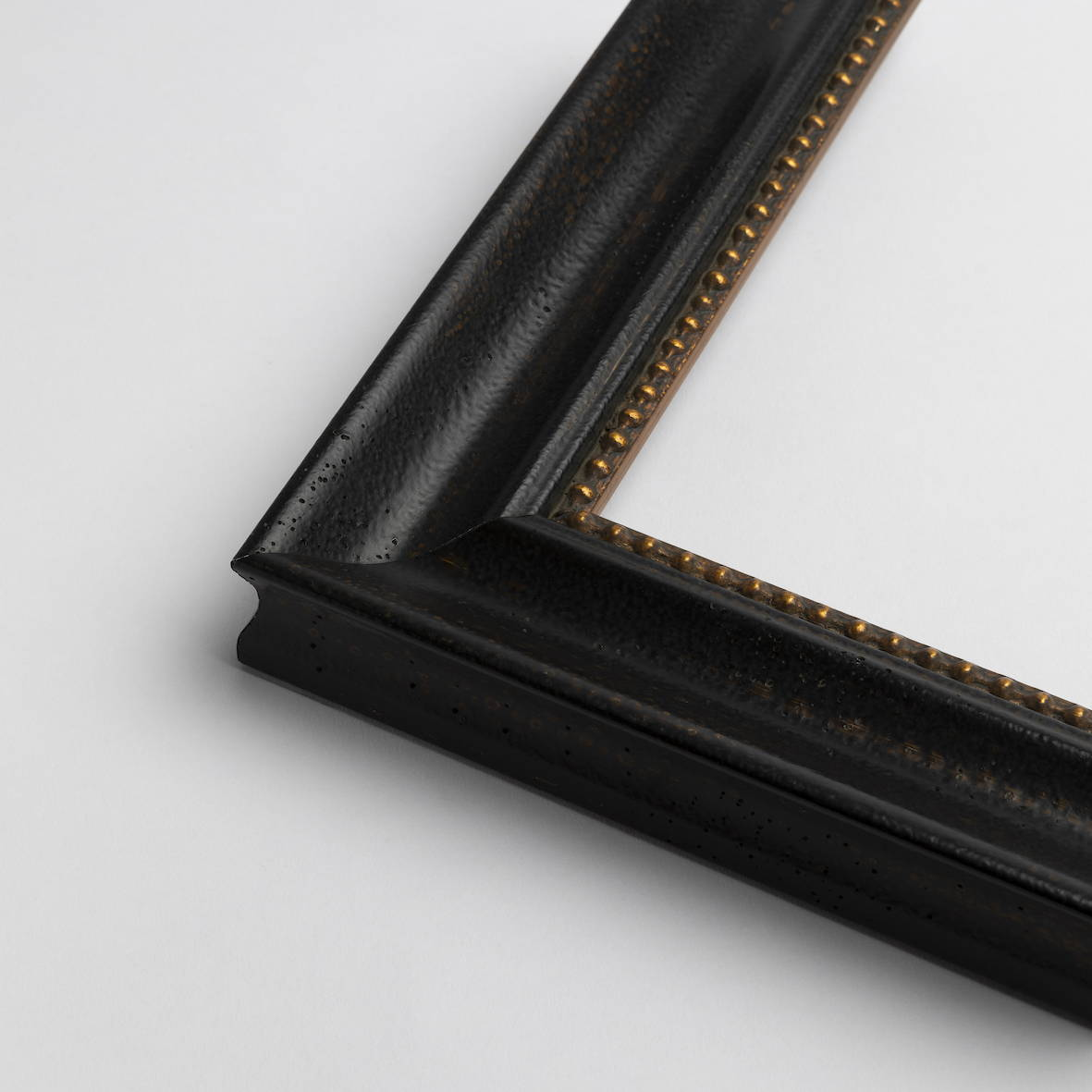 TV-Mirror Organic Black Frame with Gold Dotted Edge by FRAMING TO A T