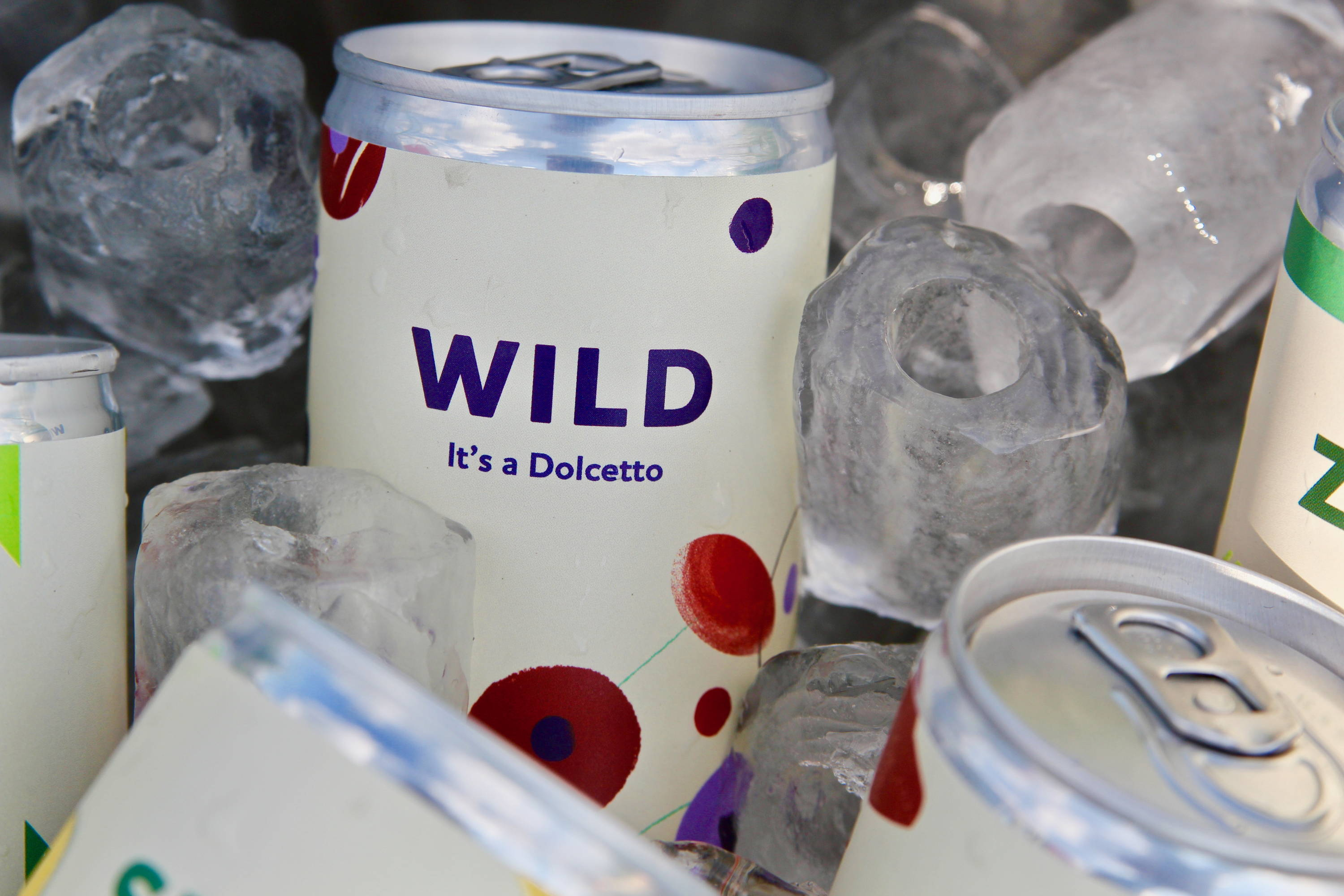 Close up of our Wild Dolcetto surrounded by ice blocks demonstrating the ideal serving temperature.