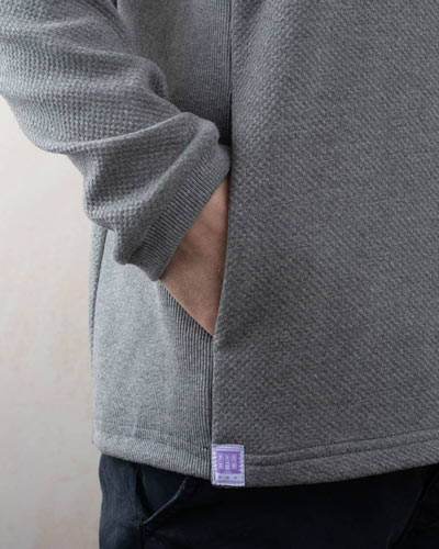 Hand in a pocket of grey Lyme Terrace organic cotton mens sweatshirt