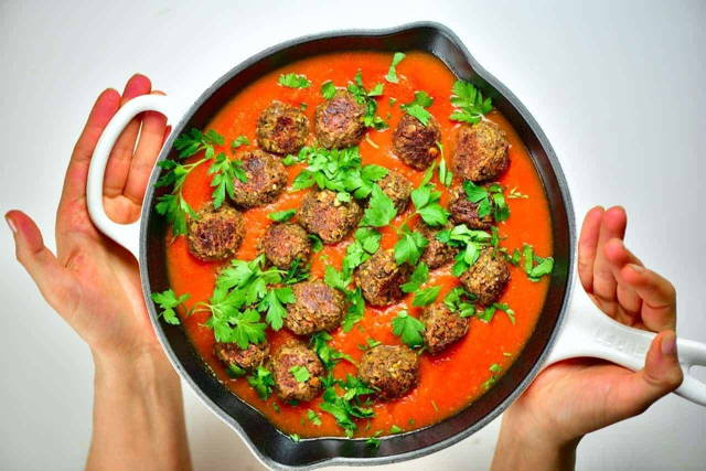 Christmas vegetarian recipes Moroccan Lentil Meatballs With Roasted Red Pepper Sauce