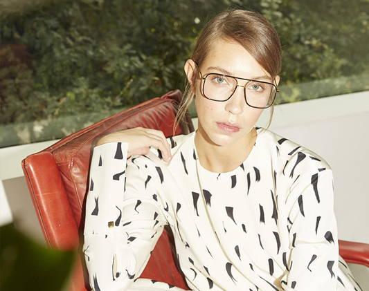 a woman wears glasses