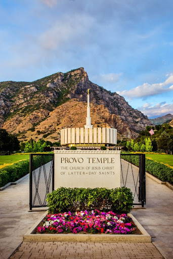 Vertical photo of the Provo Utah Temple, with the sign out front.