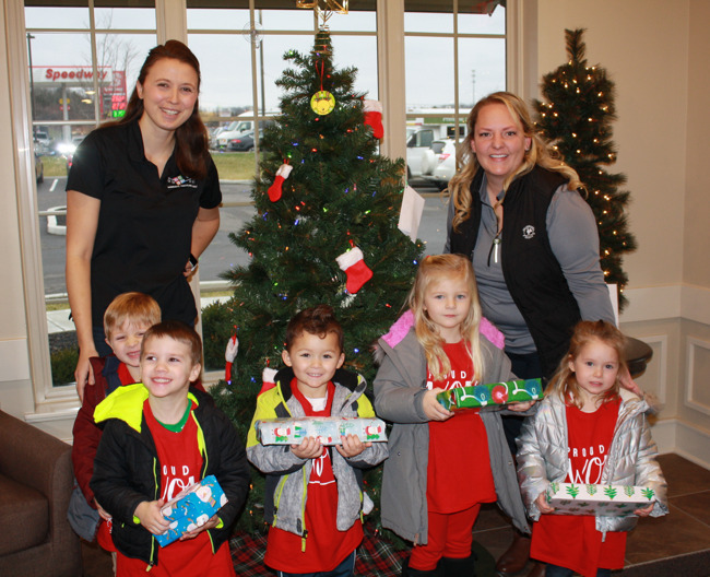 Children and teachers with gifts
