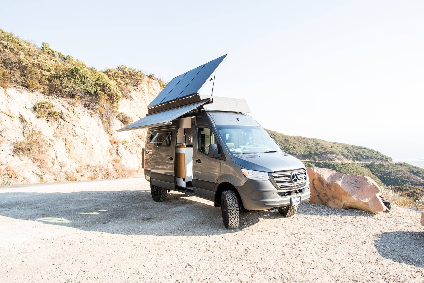 Mercedes 144 Sprinter van converted into a camper with solar panels and Flarespace flares to provide extra space.