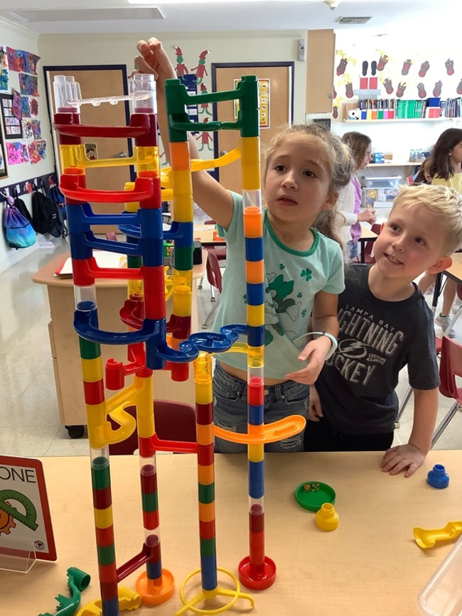 """Team work made the Dream work with our """"Future Engineers."""" Our Explorers worked together to build a marble works tower."""