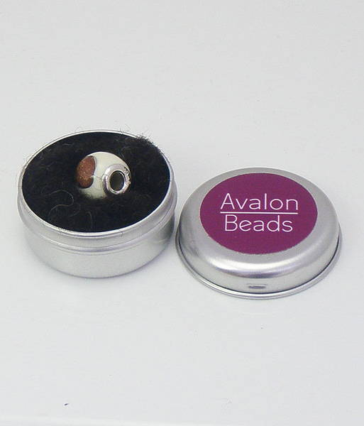A silver tin labelled which contains Jewellery