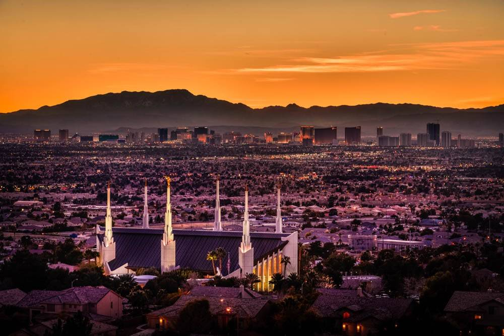 Panoramic photo of the Las Vegas Temple and surrounding city at sunset.