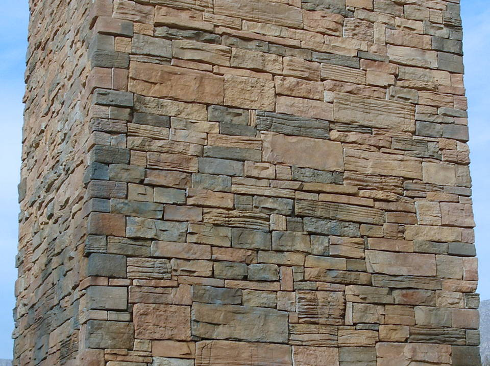 natural stone restored after being tagged with blue spray paint
