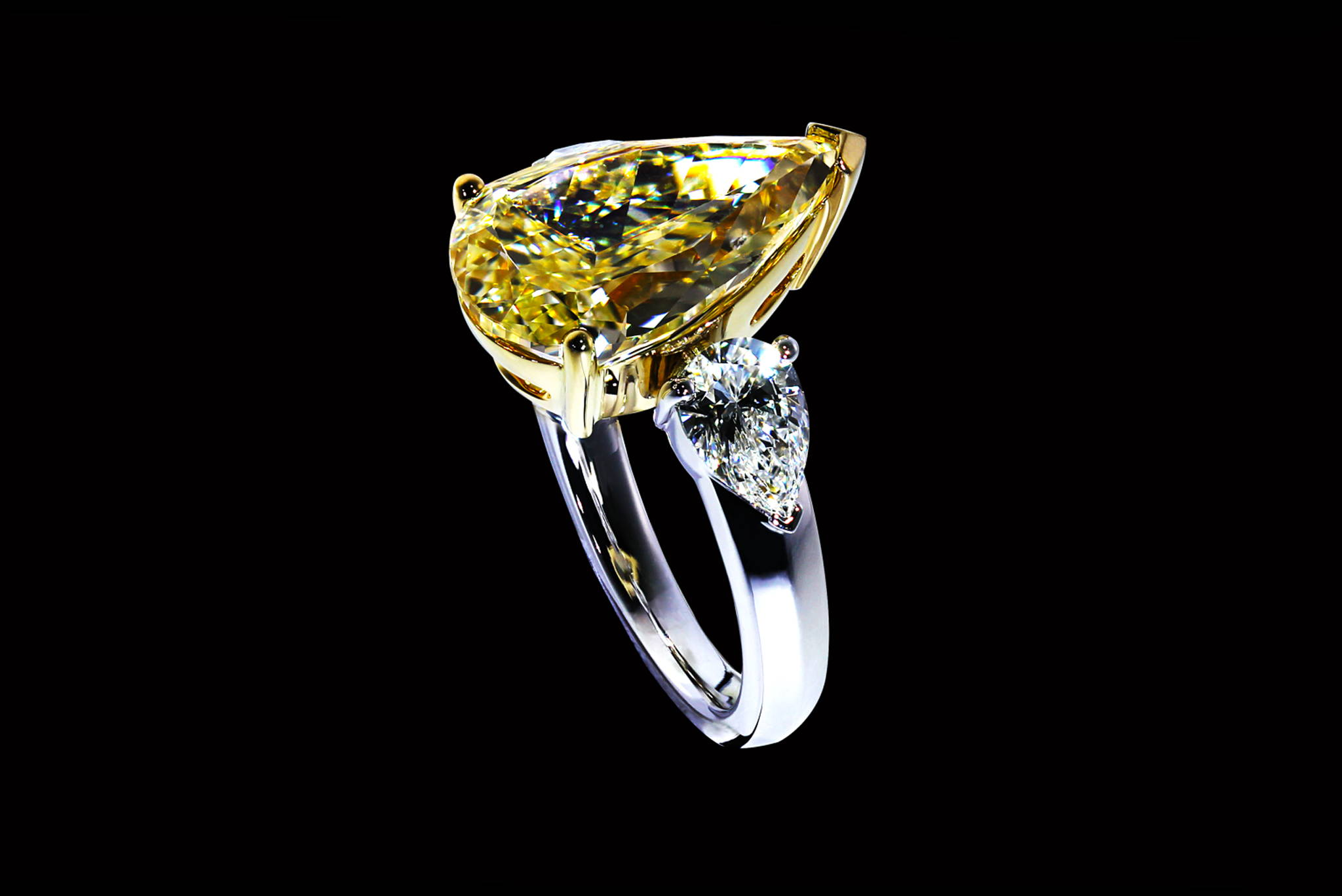 Fancy Intense Yellow Pear Shape Diamond Ring 45 degrees view